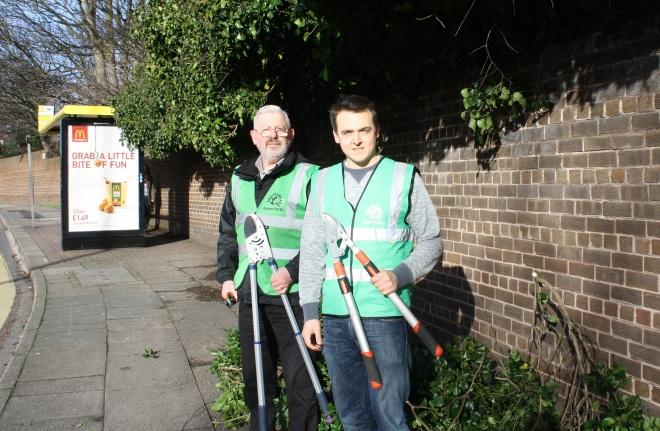 Tom Crone and Cllr John Coyne cleared the path on Aigburth Road.